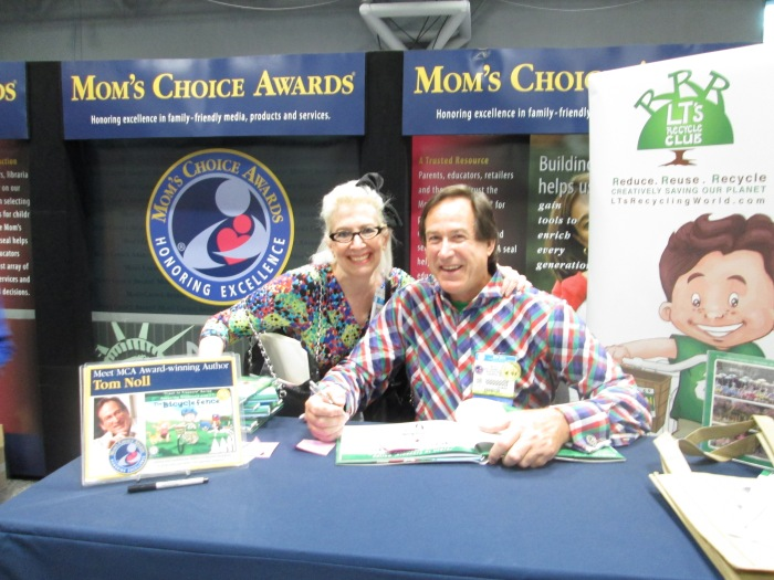 Here I am with Author, Tom Noll whose signing a children's book he wrote, The Bicycle Fence  for my niece Maya.